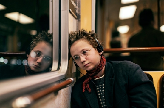 we-are-the-best!-2013-003-girl-with-headphones-on-train
