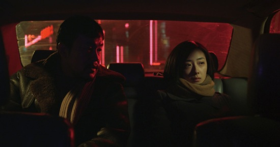 Liao Fan and Gwei Lun-mei share a cab in Black Coal, Thin Ice