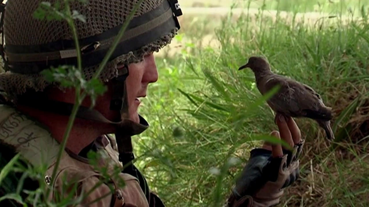 A British soldier in Afghanistan connects with a local in Adam Curtis' Bitter Lake