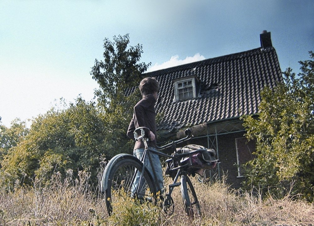 what-have-you-done-today-mervyn-day-2005-001-noah-kelly-shot-with-bicycle-in-front-of-house